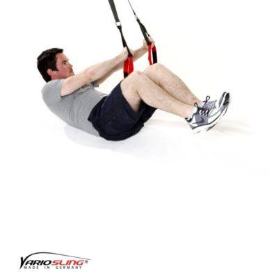 Sling-Trainer Bauchübung – Assisted Crunch Arme zur Seite mit Beine ranziehen