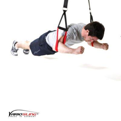 Sling-Trainer Bauchübung –  Knee Ab Beetle mit Armen auseinander